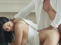 A busty princess with large tits is bending over to take in a cock
