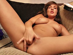 Busty honey gets down and dirty with her twat in bed