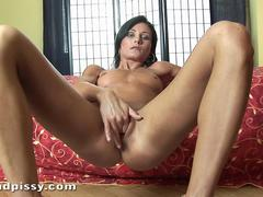 pissing all over her ripe and busty body for a fetish