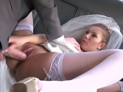 A sexy bride is getting fucked really well in the limo this day