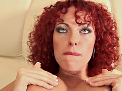 curly redhead bitch sucks on a hard cock