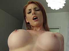 Big-breasted redhead girlfriend having sex on camera