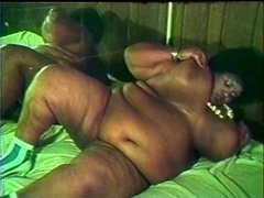 Plump black whore gives bj off 2 white knobs