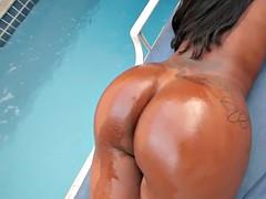 Ebony sheshaft alone in the pool