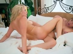 Two girls unpack their gifts and then they get naked on bed
