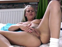 Darina Nikitina strips naked and masturbates