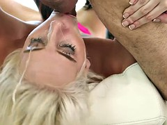 Slim blonde performs disappearing trick on a huge dick
