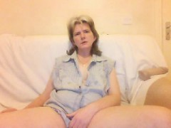 Butchy cougar in a blue top smokes a cigarette and spreads