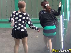 Teen ASian chicks are being watched while having a piss in a public