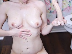 Sexy babe shoves dildo in her throat and ass