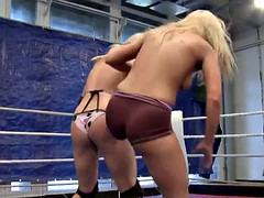 Busty lesbian wrestling with petite babe