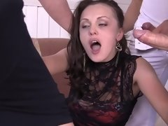 Hot chick endures a rough gangbang from three horny guys