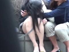 Asian slut pees outdoors