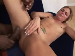 A sexy blonde is getting her clit teased by her black lover