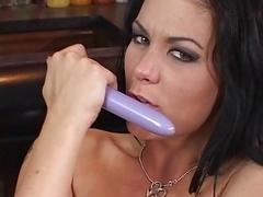 Sexy brunette slut fingers her twat & rubs her hot boobs on a chair