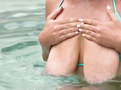 april dawn shows off her delightful parts in the pool