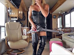 air guitar in fetish leather