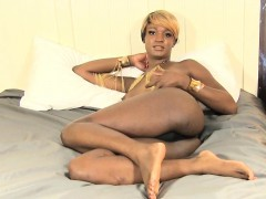Nubian transsexual strokes her dick