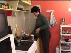 Mom and moreover son in kitchen