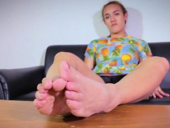 Gorgeous tgirl footworshipped in closeup