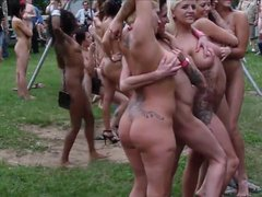Naked chicks have a lot of fun during outdoor festival