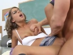 Muscled dude fucks a nerdy chick in the classroom